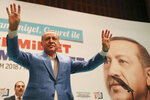 Turkey's President Recep Tayyip Erdogan waves to supporters of his ruling Justice and Development Party (AKP), during a rally in Kizilcahamam, central Turkey, Sunday, Oct. 7, 2018. When asked by journalists about Saudi writer Jamal Khashoggi, who vanished Tuesday while on a visit to the consulate, Erdogan only said