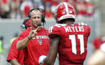 North Carolina State head coach Dave Doeren speaks with Jakobi Meyers (11) during the first half an NCAA college football game against James Madison in Raleigh, N.C., Saturday, Sept. 1, 2018. (AP Photo/Gerry Broome)