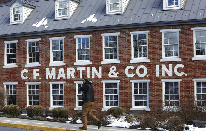 FILE - This March 23, 2018 file photo shows the exterior of C. F. Martin and Co. in Nazareth, Pa.   C.F. Martin & Co. says the guitar-maker's original factory in Pennsylvania has been named a National Historical Landmark.(AP Photo/Jacqueline Larma, File)