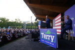 President Joe Biden speaks at a campaign event for Virginia democratic gubernatorial candidate Terry McAuliffe at Lubber Run Park, Friday, July 23, 2021, in Arlington, Va. (AP Photo/Andrew Harnik)