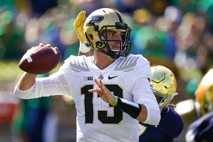 Purdue quarterback Jack Plummer (13) throws under pressure against Notre Dame during the first half of an NCAA college football game in South Bend, Ind., Saturday, Sept. 18, 2021. (AP Photo/Michael Conroy)