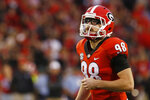 FILE - In this Nov. 18, 2017, file photo, Georgia place kicker Rodrigo Blankenship (98) gets ready to kick a field goal in the first half of an NCAA college football game against Kentucky, in Athens, Ga. While Blankenship goes with a much more subdued pair of wire-rimmed specs away from the field, he definitely needs those black, goggle-like sports glasses to see what he's doing on game day. They're not some sort of fashion statement or marketing gimmick. He's unable to wear contacts, so that's really his only option. (Joshua L. Jones/Athens Banner-Herald via AP, File)