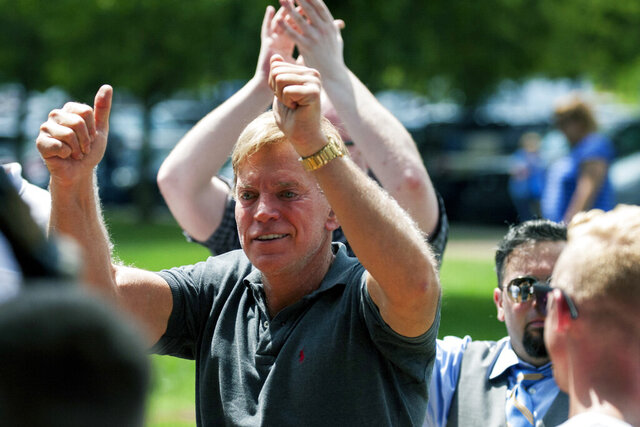 FILE - In an Aug. 12, 2017, file photo, David Duke arrives to give remarks after a white nationalist protest was declared an unlawful assembly, in Charlottesville, Va. Duke, a former Ku Klux Klan leader, has agreed to pay Bill Burke, of Athens, Ohio, $5,000 to settle allegations that Burke was severely injured during a white supremacist and neo-Nazi rally two years ago in Virginia attended by Duke, according to attorneys and court documents. (Shaban Athuman/Richmond Times-Dispatch via AP, File)