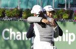Nasa Hataoka, right, of Japan hugs Minjee Lee of Australia after finishing the first round of the LPGA KEB Hana Bank Championship at Sky72 Golf Club in Incheon, South Korea, Thursday, Oct. 11, 2018. (AP Photo/Ahn Young-joon)