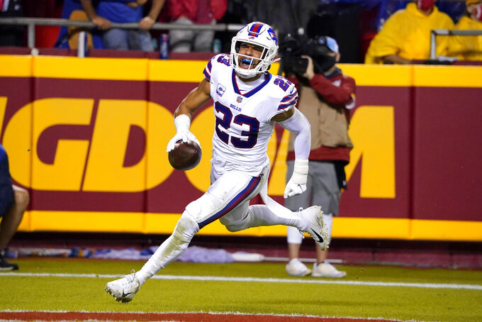 Buffalo Bills safety Micah Hyde celebrates after running an interception back for a touchdown during the second half of an NFL football game against the Kansas City Chiefs Sunday, Oct. 10, 2021, in Kansas City, Mo. (AP Photo/Ed Zurga)