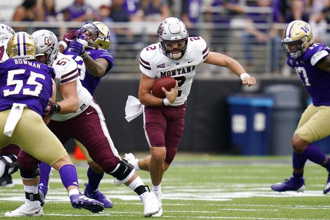 Montana quarterback Cam Humphrey (2) scrambles against Washington in the first half of an NCAA college football game Saturday, Sept. 4, 2021, in Seattle. (AP Photo/Elaine Thompson)