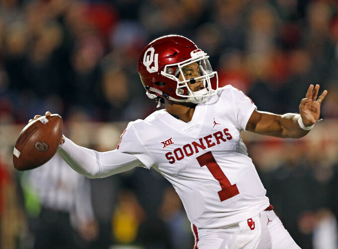 Oklahoma's Kyler Murray (1) passes the ball downfield during the first half of an NCAA college football game against Texas Tech, Saturday, Nov. 3, 2018, in Lubbock, Texas. (AP Photo/Brad Tollefson)