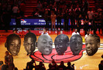 Cutout heads chronicling the career of Miami Heat guard Dwyane Wade sit on the court during a ceremony to honor Wade who is playing his final home regular season game when the Heat host the Philadelphia 76ers, Tuesday, April 9, 2019, in Miami. Wade is retiring at the end of the season. (AP Photo/Lynne Sladky)
