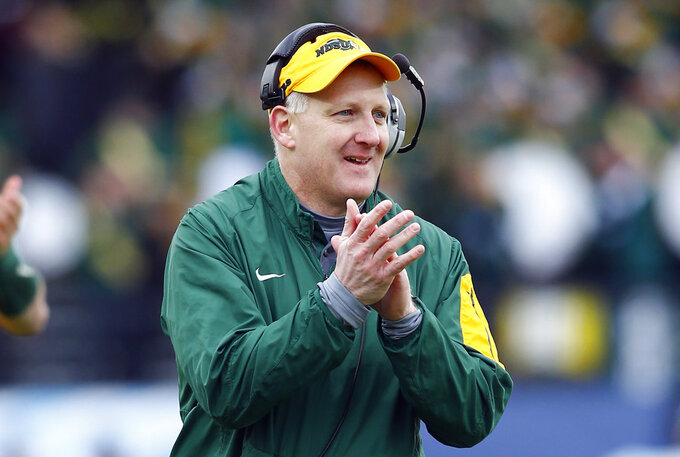 FILE - In this Jan. 9, 2016, file photo, North Dakota State head coach Chris Klieman reacts during the FCS championship NCAA college football game against Jacksonville State in Frisco, Texas. Klieman (68-6), who will be Kansas State's new coach, is going for his fourth FCS title as a head coach to match the record four won by Jim Tressel at Youngstown State before he went on to win a national title at Ohio State. (AP Photo/Mike Stone, File)