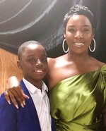 This undated image released by Warner Records shows Keedron Bryant, left, with his mother Johnnetta. Keedron Bryant, the 12-year-old who turned heads on social media with his passionate performance about being a young black man in today's world, has signed a deal with Warner Records and will officially release his song that went viral on Friday. (Johnnetta Bryant/Warner Records via AP)