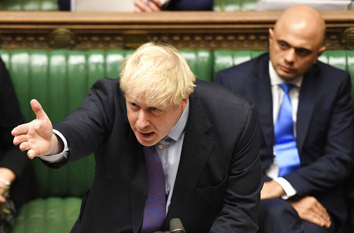 Britain's Prime Minister Boris Johnson gestures as he speaks in the House of Commons in London during the debate for the EU Withdrawal Agreement Bill, Tuesday Oct. 22, 2019. British lawmakers have rejected the government's fast-track attempt to pass its Brexit bill within days, demanding more time to scrutinize the complex legislation and throwing Prime Minister Boris Johnson's exit timetable into chaos. (Jessica Taylor, UK Parliament via AP)