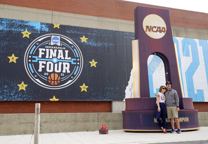 Fans pose with a mock championship trophy before Baylor plays Gonzaga in the NCAA tournament championship basketball game at Lucas Oil Stadium in Indianapolis, Monday, April 5, 2021. (AP Photo/AJ Mast)