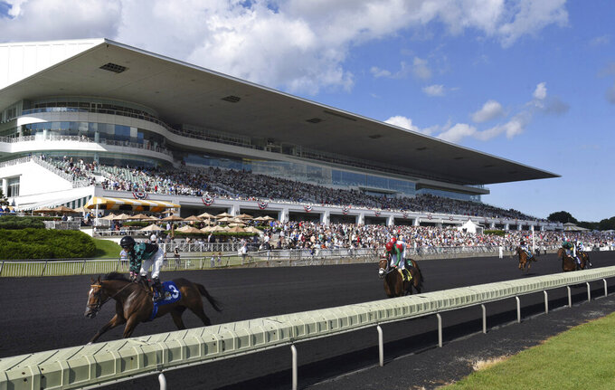 FILE - In this Aug. 12, 2017, file photo, horses in the Bruce D. Memorial Stakes pass the grandstand at Arlington International Racecourse in Arlington Heights, Ill. The Chicago Bears announced the signing Wednesday, Sept. 29, 2021, of an agreement to purchase Arlington Park racetrack in Arlington Heights, the latest step toward a move from their longtime home, Soldier Field in Chicago. ( John Starks/Daily Herald via AP, File)