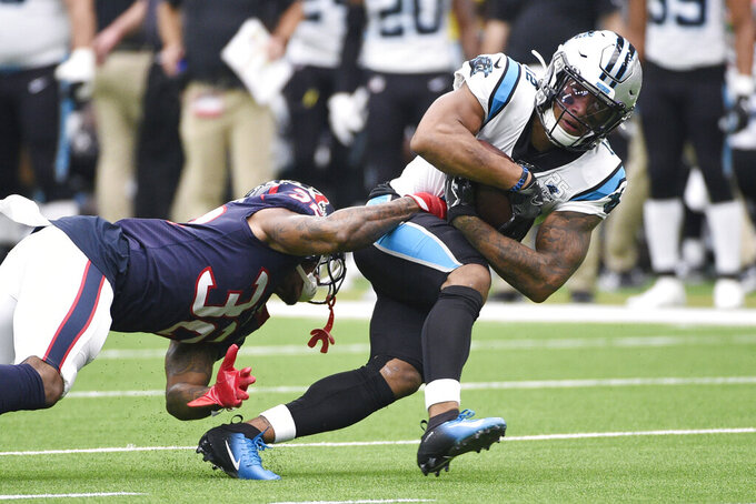 Carolina Panthers wide receiver D.J. Moore (12) runs past Houston Texans cornerback Lonnie Johnson (32) after a catch during the first half of an NFL football game Sunday, Sept. 29, 2019, in Houston. (AP Photo/Eric Christian Smith)