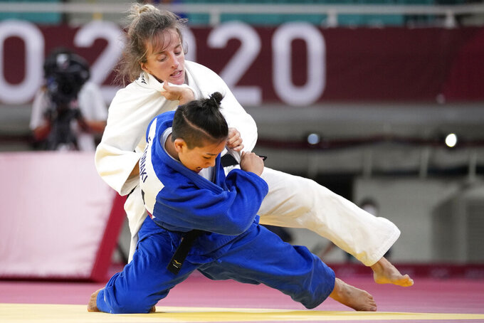 Distria Krasniqi of Kosovo, top, and Funa Tonaki of Japan compete during their women's -48kg championship judo match at the 2020 Summer Olympics, Saturday, July 24, 2021, in Tokyo, Japan. (AP Photo/Vincent Thian)