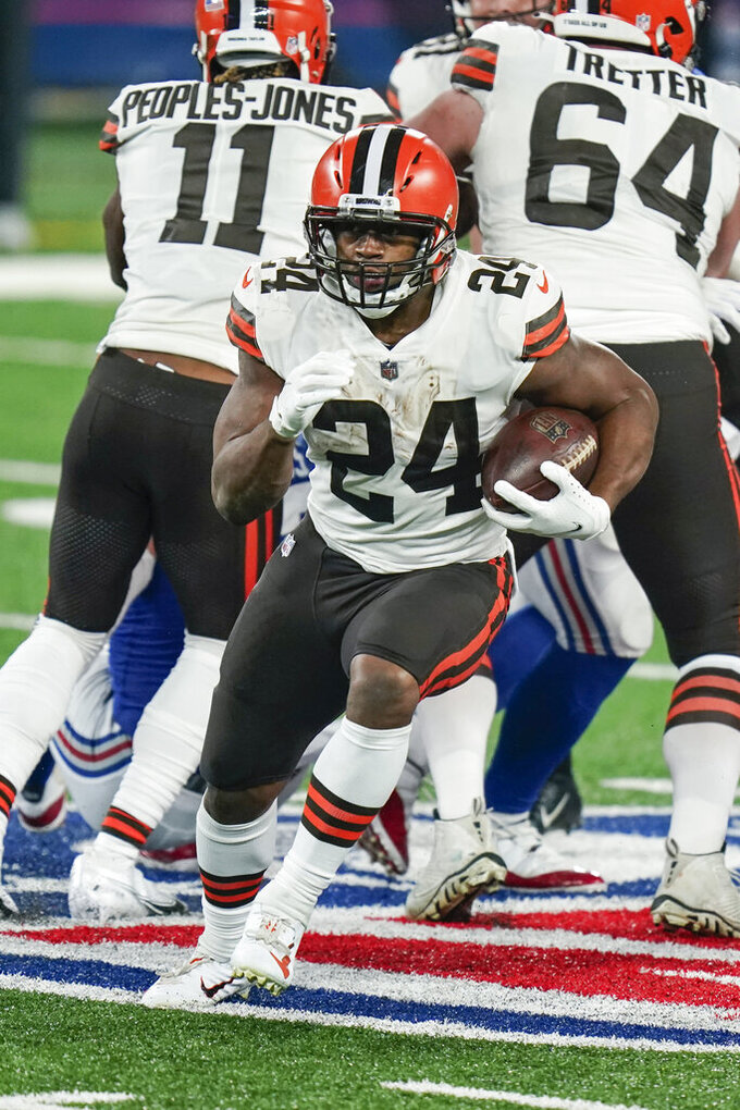 Cleveland Browns' Nick Chubb (24) rushes during the second half of an NFL football game against the New York Giants Sunday, Dec. 20, 2020, in East Rutherford, N.J. (AP Photo/Seth Wenig)