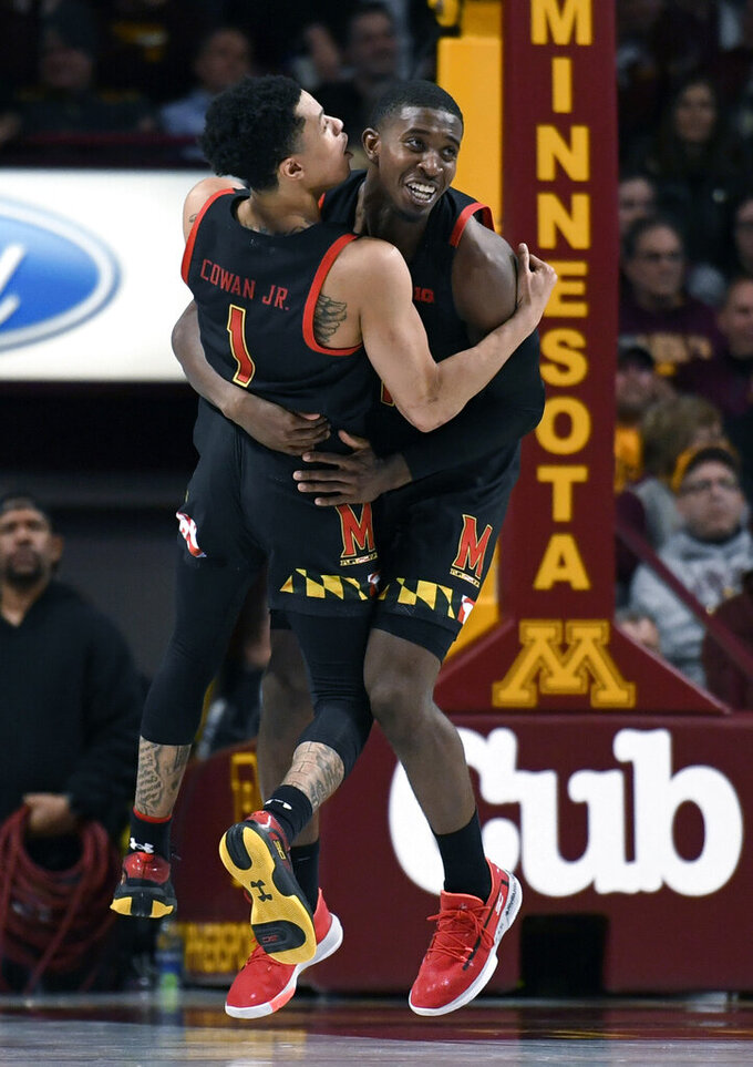 Maryland's Anthony Cowan Jr. (1) and Darryl Morsell celebrate the go-ahead 3-point basket against Minnesota by Morsell late in the second half of an NCAA college basketball game Wednesday, Feb. 26, 2020, in Minneapolis. Maryland won 74-73. (AP Photo/Hannah Foslien)