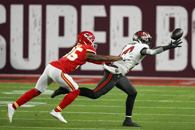 Kansas City Chiefs cornerback Charvarius Ward breaks up a pass intended for Tampa Bay Buccaneers wide receiver Chris Godwin during the first half of the NFL Super Bowl 55 football game Sunday, Feb. 7, 2021, in Tampa, Fla. (AP Photo/David J. Phillip)