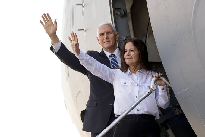 FILE - In this Nov. 23, 2019 file photo, Vice President Mike Pence and his wife Karen Pence board a military cargo jet at Al Asad Air Base, to travel to Erbil, Iraq. (AP Photo/Andrew Harnik)