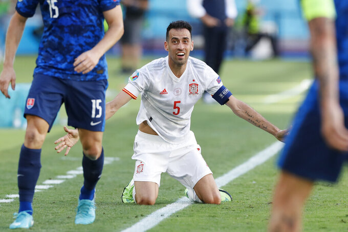 Spain's Sergio Busquets gestures during the Euro 2020 soccer championship group E match between Spain and Slovakia at La Cartuja stadium in Seville, Wednesday, June 23, 2021. (AP Photo/Jose Manuel Vidal, Pool)