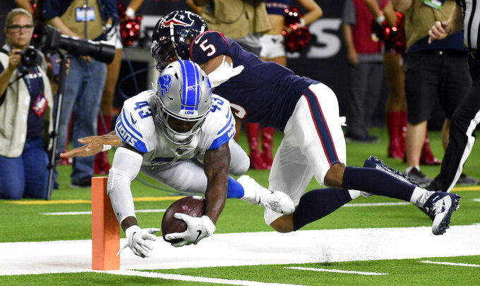 Detroit Lions defensive back Will Harris (43) dives to score a touchdown after recovering a fumble as Houston Texans quarterback Joe Webb III (5) tackles him during the first half of an NFL preseason football game Saturday, Aug. 17, 2019, in Houston. (AP Photo/Eric Christian Smith)