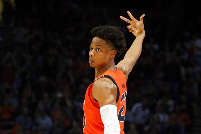Auburn forward Isaac Okoro (23) celebrates making a three-point basket against Saint Louis during the second half of an NCAA college basketball game Saturday, Dec. 14, 2019, in Birmingham, Ala. (AP Photo/Butch Dill)