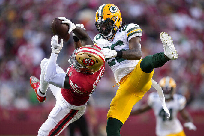 Green Bay Packers free safety Darnell Savage, right, defends a pass intended for San Francisco 49ers wide receiver Deebo Samuel during the first half of an NFL football game in Santa Clara, Calif., Sunday, Sept. 26, 2021. (AP Photo/Tony Avelar)