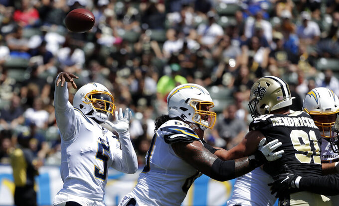 Los Angeles Chargers quarterback Tyrod Taylor (5) throws against the New Orleans Saints during the first half of a preseason NFL football game Sunday, Aug. 18, 2019, in Carson, Calif. (AP Photo/Gregory Bull)