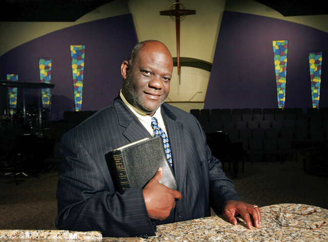 "FILE - In this Wednesday, Oct. 4, 2006 file photo, the Rev. Dwight McKissic poses for a portrait in the sanctuary of the Cornerstone Baptist Church in Arlington, Texas. In late May 2020, he recorded a fiery, 4-minute statement that he aired on social media, denouncing the police actions that have cost Floyd and other blacks their lives. ""America now has seen exactly what black America has been knowing for a couple of hundred years,"" he said. ""No one can now say that racism is a myth."" (AP Photo/Tony Gutierrez)"