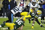 Green Bay Packers' Jamaal Williams is stopped on a run during the first half of an NFL football game against the Carolina Panthers Sunday, Nov. 10, 2019, in Green Bay, Wis. (AP Photo/Mike Roemer)