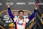 Denny Hamlin celebrates after winning a NASCAR Cup Series auto race at Kansas Speedway in Kansas City, Kan., Thursday, July 23, 2020. (AP Photo/Charlie Riedel)