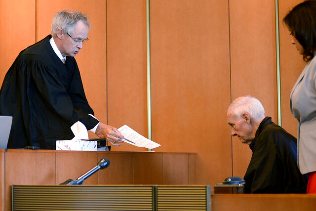 FILE - In this Monday, Aug. 10, 2015 file photo, Judge Timothy Feeley, left, addresses former the Rev. Richard J. McCormick, 74, in Salem Superior Court in Boston. Joey Covino said the entirety of his adult life had been altered by McCormick's abuse over two summers at a Salesian camp - failed relationships, his decisions to join the military and later the police, nightmares that plagued him. His decision to come forward led to McCormick being convicted of rape in 2014 and sentenced to up to 10 years. McCormick since has pleaded guilty to assaulting another boy. (Faith Ninivaggi/The Boston Herald via AP, Pool)