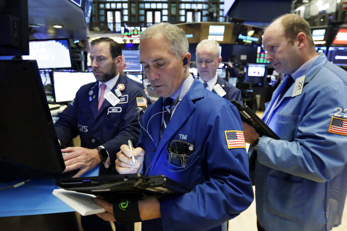 Timothy Nick, foreground center, works with fellow traders on the floor of the New York Stock Exchange, Thursday, May 17, 2018. U.S. stocks edged higher in morning trading Thursday, having shaken off an early stumble, as investors weighed the latest batch of company earnings news. (AP Photo/Richard Drew)