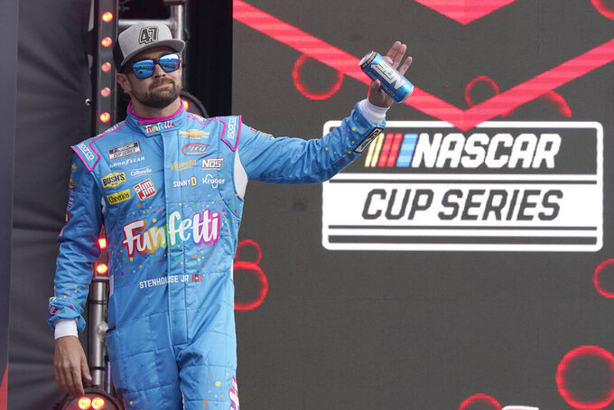 Ricky Stenhouse,Jr., waves to fans during driver introductions before theNASCAR Cup Series auto race at Daytona International Speedway, Saturday, Aug. 28, 2021, in Daytona Beach, Fla. (AP Photo/John Raoux)