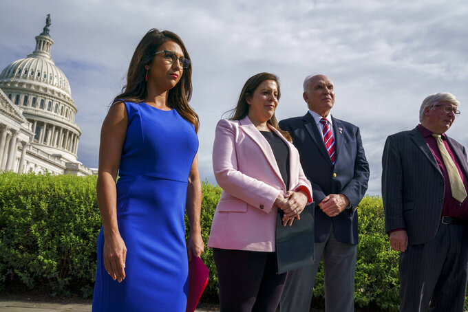 FILE - In this July 1, 2021, file photo from left, Rep. Lauren Boebert, R-Colo., House Republican Conference Chair Elise Stefanik, R-N.Y., Rep. Mike Kelly, R-Pa., and Rep. Glenn Grothman, R-Wis., wait to speak about introducing legislation to limit Facebook CEO Mark Zuckerberg's donations, at the Capitol in Washington. Zuckerberg donated $400 million to help fund election offices as they scrambled to deal with the coronavirus pandemic late last summer. At least eight GOP-controlled states have passed bans on donations to election offices this year as Republicans try to block outside funding of voting operations. (AP Photo/J. Scott Applewhite, File)