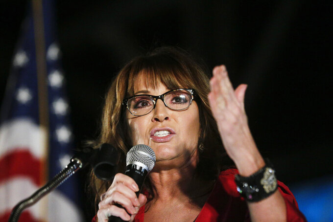 FILE - In this Sept. 21, 2017, file photo, former vice presidential candidate Sarah Palin speaks at a rally in Montgomery, Ala. Palin says she tested positive for COVID-19 and is urging people to take steps to guard against the coronavirus, including wearing masks in public. (AP Photo/Brynn Anderson, File)