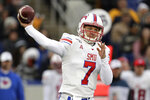 SMU quarterback Shane Buechele throws a pass against Navy during the first half of an NCAA college football game, Saturday, Nov. 23, 2019, in Annapolis, Md. (AP Photo/Julio Cortez)