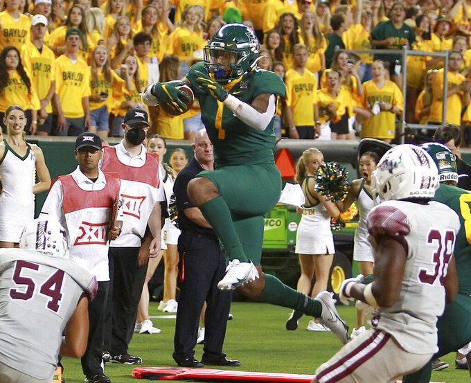 Baylor running back Trestan Ebner (1) leaps into the end zone against Texas Southern in the second half of an NCAA college football game, Saturday, Sept. 11, 2021, in Waco, Texas. (Lauryn Amy/Waco Tribune-Herald via AP)