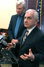 U.S. Sens. Jack Reed, front, and Sheldon Whitehouse discuss the impeachment trial of President Donald Trump, Friday, Jan. 17, 2020, at Reed's office in Cranston, R.I. The Rhode Island Democrats spoke about the importance of calling witnesses for the trial. (AP Photo/Jennifer McDermott)