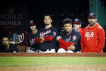 Members of the Washington Nationals watch during the ninth inning of Game 4 of the baseball World Series against the Houston Astros Saturday, Oct. 26, 2019, in Washington. The Astros won 8-1 to tie the series 2-2. (AP Photo/Patrick Semansky)