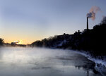 Steam rises from the Mississippi River along West River Parkway, Thursday, Feb. 13, 2020, near downtown Minneapolis, as temperatures hover near minus 30 degrees Fahrenheit with wind chills. (David Joles/Star Tribune via AP)