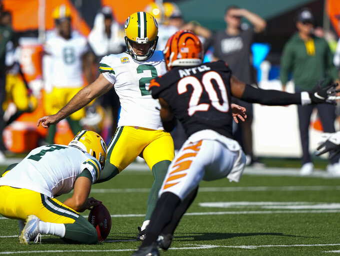 Green Bay Packers kicker Mason Crosby (2) misses a field goal from the hold of Corey Bojorquez in the second half of an NFL football game against the Cincinnati Bengals in Cincinnati, Sunday, Oct. 10, 2021. (AP Photo/AJ Mast)