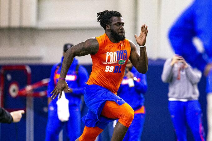 Defensive lineman Jachai Polite runs the 40-yard dash during University of Florida's football Pro Day in Gainesville, Fla., Wednesday, March 27, 2019.  (Lauren Bacho/The Gainesville Sun via AP)