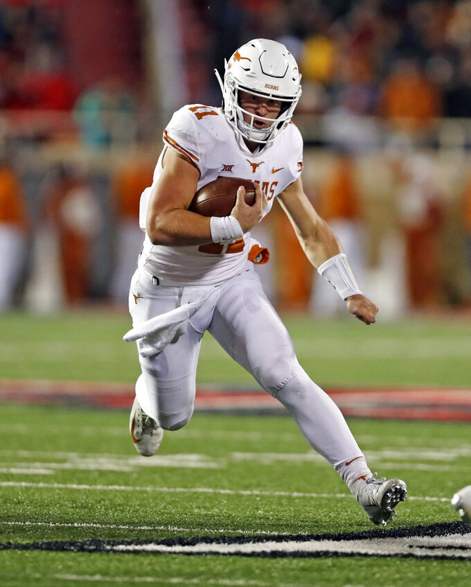 Texas' Sam Ehlinger runs with the ball during the second half of an NCAA college football game against Texas Tech, Saturday, Nov. 10, 2018, in Lubbock, Texas. (AP Photo/Brad Tollefson)