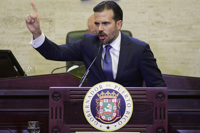 Puerto Rico's Gov. Ricardo Rossello delivers his commonwealth addressat the seaside Capitol in San Juan, Puerto Rico, Wednesday, April 24, 2019. He pledged on Wednesday to lift the U.S. territory from a deep recession by creating more jobs, reversing a migration exodus and implementing a range of incentives as the island struggles to recover from Hurricane Maria. (AP Photo/Carlos Giusti)