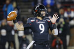 Cincinnati quarterback Desmond Ridder (9) passes during the first half of an NCAA college football game against Temple, Saturday, Nov. 23, 2019, in Cincinnati. (AP Photo/John Minchillo)