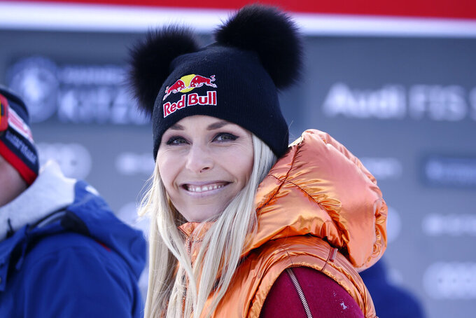 FILE- In this Friday, Jan. 24, 2020, file photo, Former ski star Lindsey Vonn, of United States, smiles in the finish area during the men's World Cup super G alpine ski race in Kitzbuehel, Austria. Vonn, the winningest woman in World Cup history, is scheduled to call the women's downhill and super-G races in Crans Montana, Switzerland, this weekend for NBC Sports. (AP Photo/Marco Trovati, File)