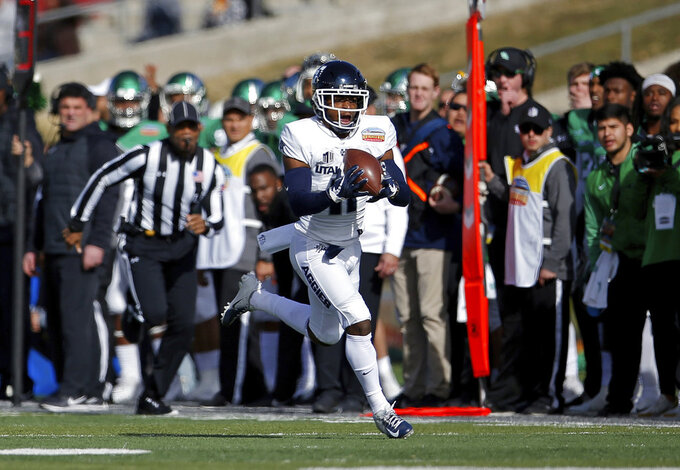 Utah State wide receiver Aaren Vaughns catches a pass before scoring a touchdown against North Texas during the first half of the New Mexico Bowl NCAA college football game in Albuquerque, N.M., Saturday, Dec. 15, 2018. (AP Photo/Andres Leighton)