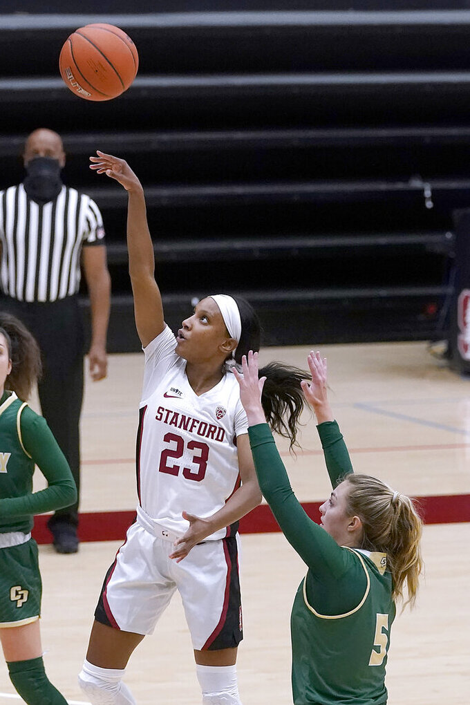 Stanford guard Kiana Williams (23) shoots past Cal Poly guard Malia Holt during the first half of an NCAA college basketball game in Stanford, Calif., Wednesday, Nov. 25, 2020. (AP Photo/Tony Avelar)