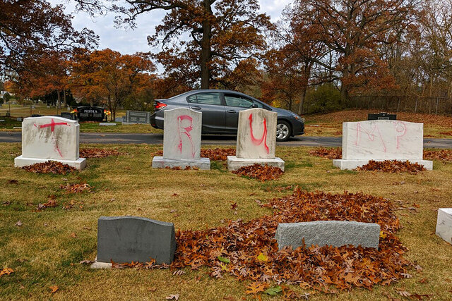 This photo provided by the Anti- Defamation League Michigan shows headstones at a Jewish cemetery in Grand Rapids, Mich., spray-painted with